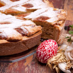 International Cuisine - Desserts - Neapolitan Pastiera and handmade painted egg. Pastiera is a wheat and ricotta pie that is also known as Pizza Gran.